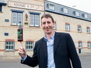 Adnams Managing Director Andy Wood with bottle of East Green