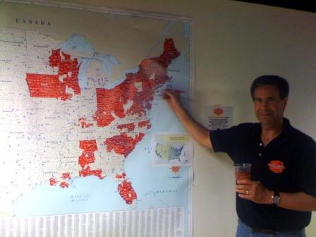 "John Timson, VP of Marketing and Sales, points to Hook and Ladder Brewing Company's ""World Domination Plan"""